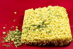 Instant noodles. On a red background Stock Photos