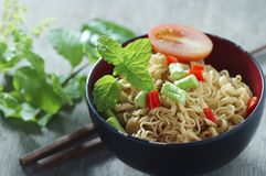 Instant noodles with shiitake pepper and chilli in  bowl,. Instant noodles with shiitake pepper and chilli n a bowl, Asian meal on a table Stock Photography