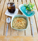 Instant noodles and soft drink on wood table Royalty Free Stock Photography