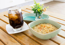 Instant noodles and soft drink on wood table Royalty Free Stock Images