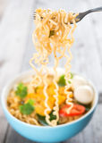 Instant noodles soup. Hot and spicy instant noodles soup, in curry flavour Stock Image