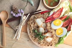 Instant noodles soup put crispy pork and egg Royalty Free Stock Images