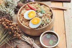 Instant noodles soup put egg Royalty Free Stock Photo