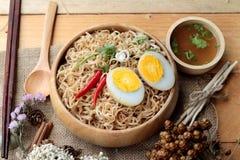 Instant noodles soup put egg Royalty Free Stock Images