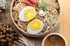 Instant noodles soup put egg Stock Photo
