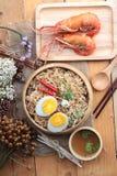 Instant noodles soup put egg and shrimp Royalty Free Stock Images