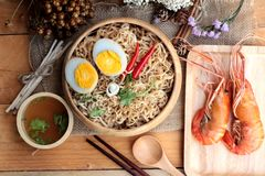 Instant noodles soup put egg and shrimp Stock Image