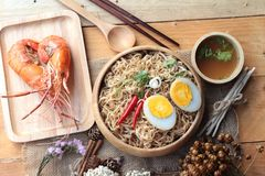 Instant noodles soup put egg and shrimp Royalty Free Stock Photo