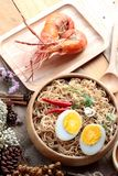 Instant noodles soup put egg and shrimp Royalty Free Stock Photography