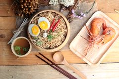 Instant noodles soup put egg and shrimp Royalty Free Stock Photo