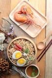 Instant noodles soup put egg and shrimp Stock Photos