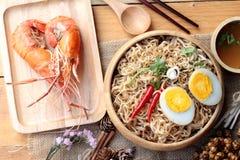 Instant noodles soup put egg and shrimp Stock Images