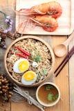 Instant noodles soup put egg and shrimp Royalty Free Stock Image