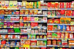 Instant noodles on supermarket shelves. Assortment of flavored instant noodles displayed on shelves at a supermarket in hong kong