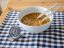 Instant noodles with thermometer. Royalty Free Stock Image