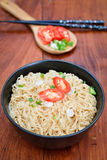 Instant noodles to eat sliced onions and peppers. On wooden table Royalty Free Stock Images
