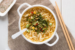 Instant noodles in a white plate with vegetables Royalty Free Stock Image