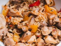 Instant noodles or wok with vegetables and chicken meat with spices and hot sauce. Traditional Asian food. Close-up royalty free stock photos