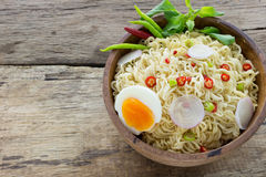 Instant noodles on wooden. Instant noodles on a wooden Royalty Free Stock Images