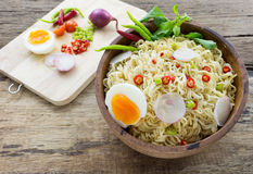 Instant noodles on wooden. Instant noodles on a wooden Royalty Free Stock Photo