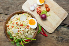 Instant noodles on wooden. Instant noodles on a wooden Royalty Free Stock Photography