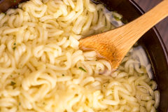 Instant noodles in a wooden bowl Stock Photography