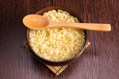 Instant noodles in a wooden bowl Stock Photos