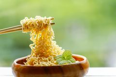 Instant Noodles on Wooden Table on green background. Stock Photography