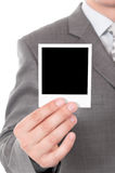 Instant photo. Man holds a instant photo. Focus on instant photo Stock Images