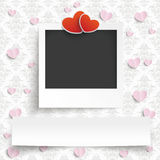 Instant Photo Banner 2 Hearts Ornaments Wallpaper. Instant photo with banner and 2 hearts on the wallpaper with ornaments Royalty Free Stock Photo