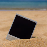 Instant photo on a beach Stock Images