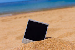 Instant photo on a beach Royalty Free Stock Image