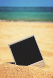 Instant photo on a beach Stock Image