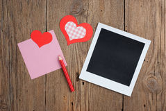 Instant photo with blank note, pencil and heart Royalty Free Stock Photo