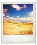 Instant photo of dunes and sky Stock Image