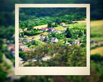 Photo frame with view on a village Royalty Free Stock Photography