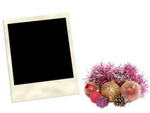 Instant photo frame and Christmas ornaments Royalty Free Stock Photography