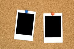 Instant photo frame on cork board Stock Photography