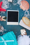 Instant photo with frame of sea salt and shells Stock Photos