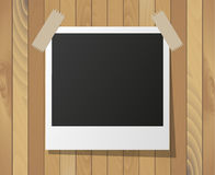 Instant photo frame on wooden background Royalty Free Stock Image