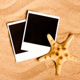 Instant photo frames on the beach Stock Photography