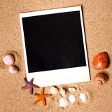 Instant photo frames on the beach Stock Photo