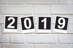 2019 in instant photo frames on a brick wall. 2019, in instant photo frames on a brick wall stock photos