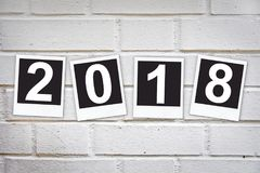 2018 in instant photo frames on a brick wall Royalty Free Stock Images