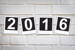 2016 in instant photo frames on a brick wall Royalty Free Stock Images