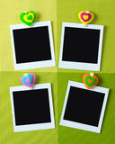 Instant photo frames with heart shape peg Stock Photo