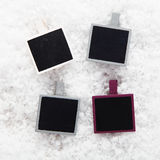 Instant photo frames on snow Royalty Free Stock Images