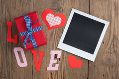 Instant photo with gift and hearts Stock Photo