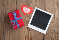 Instant photo with gift and hearts Royalty Free Stock Photography
