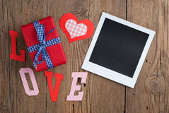 Instant photo with gift and hearts Royalty Free Stock Images